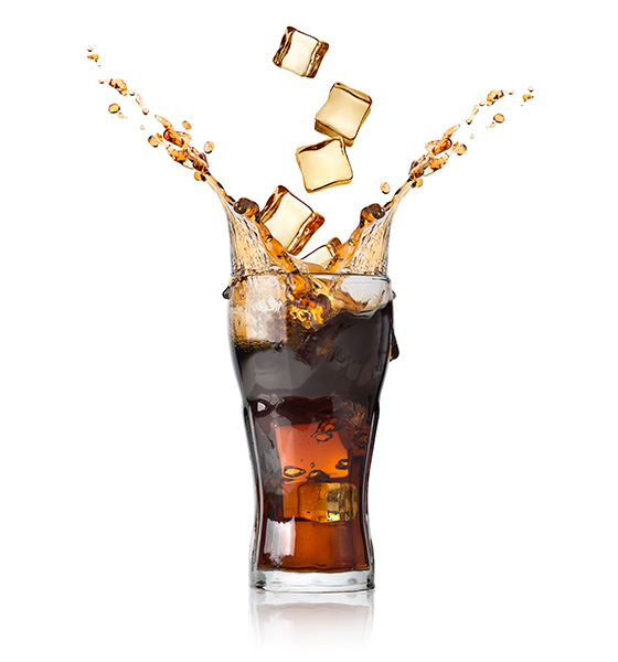 Cola soda in a glass with ice cubs