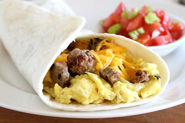 Breakfast wrap with sausage, eggs, and cheese